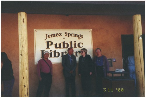 Standing in front of the new sign are Ben Wakashige, State Librarian; Ed Norris, architect; Toni Beatty, Library Director, Rio Rancho Public Library; and Judith Isaacs, Library Director.