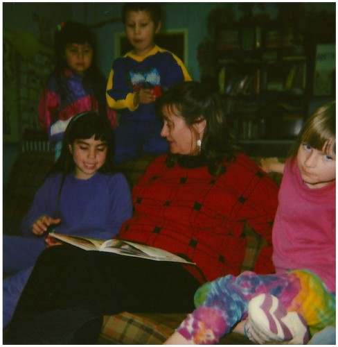 Alice Rodgers, Volunteer, reads to children in the program.