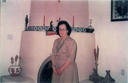 Jane Sanchez picture was taken at Dora's home in Los Lunas on July 24, 1992. On right hand corner of picture you see a picture of Dora's husband's grandfather (Boleslo Romero) of Los Lunas—who was in the FIRST SENATE in 1912.